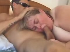 Giant fatty w big tits sucking cock