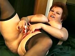 Busty housewife caresses her pussy
