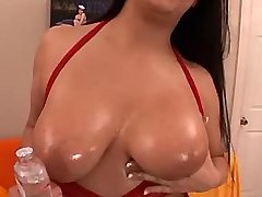 Busty mature caresses her huge tits