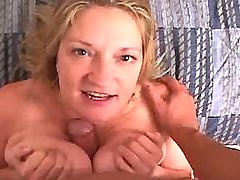 Lewd chesty mature sucking big cock
