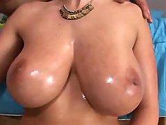 Babe with huge boobs sucks big cock