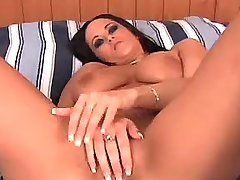 Busty brunette accepts cock on tits