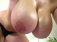 Busty plumper shows her huge tits